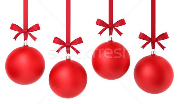 Four hanging christmas balls with nice bow Stock photo © montego