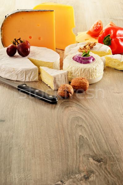 Különböző sajt fa asztal étel asztal bors Stock fotó © monticelllo