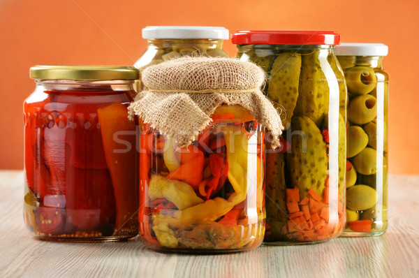 Composition with jars of pickled vegetables. Marinated food Stock photo © monticelllo