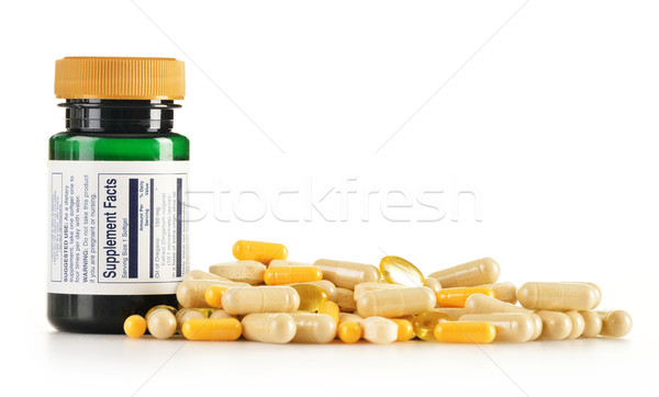 Composition with dietary supplement capsules. Drug pills Stock photo © monticelllo