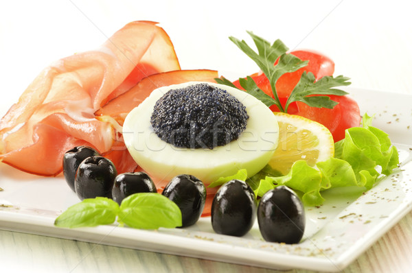 Egg with caviar and garnish Stock photo © monticelllo