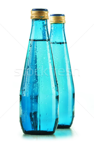 Glass bottle of mineral water isolated on white Stock photo © monticelllo