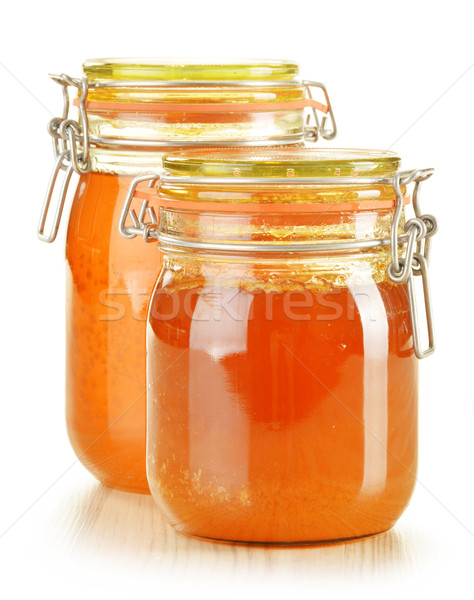 Composition with jar of honey isolated on white Stock photo © monticelllo