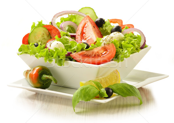 Vegetable salad bowl isolated on white Stock photo © monticelllo