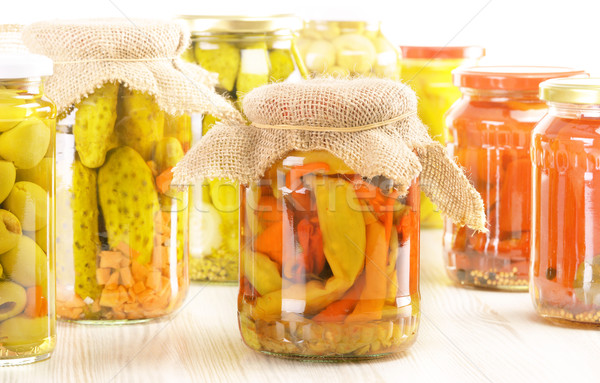 Composition with jars of pickled vegetables. Marinated food.  Stock photo © monticelllo
