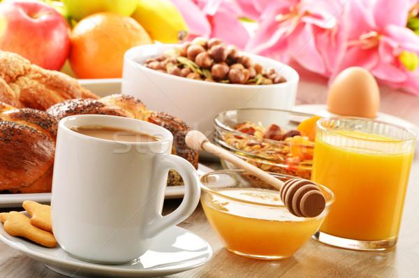 Breakfast including coffee, bread, honey, orange juice, muesli a Stock photo © monticelllo