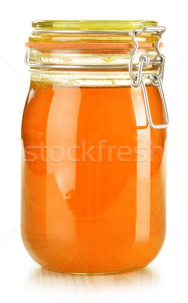 Jar of honey isolated on white Stock photo © monticelllo