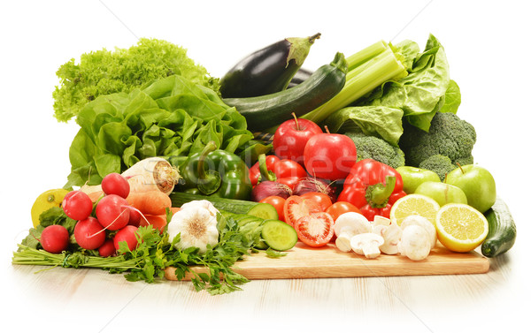 Composition with raw vegetables isolated on white Stock photo © monticelllo