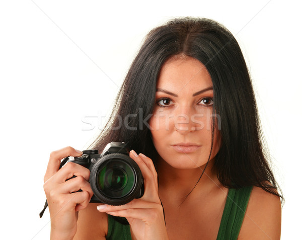 Young woman holding camera isolated on white Stock photo © monticelllo