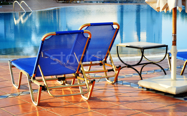 Swimming pool in touristic resort during summer time Stock photo © monticelllo