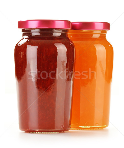 Two jars of fruity jams isolated on white. Preserved fruits Stock photo © monticelllo