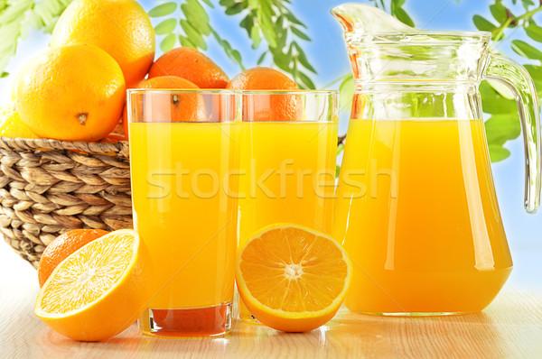 Kettő szemüveg narancslé gyümölcsök fa pár Stock fotó © monticelllo