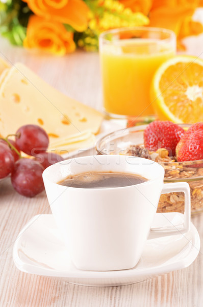 Reggeli asztal kávé narancslé tekercsek müzli Stock fotó © monticelllo