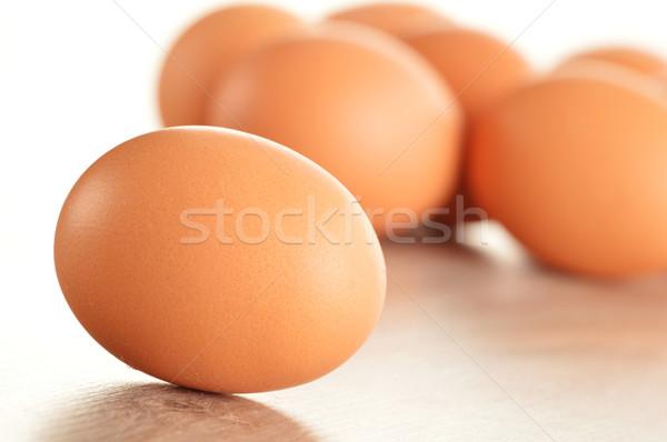 Chicken eggs on kitchen table Stock photo © monticelllo