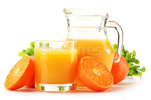 Composition with glass and jug of orange juice isolated on white Stock photo © monticelllo