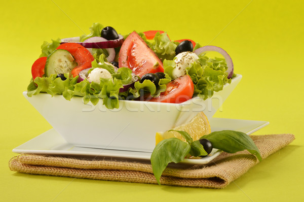 Vegetable salad bowl on green background Stock photo © monticelllo