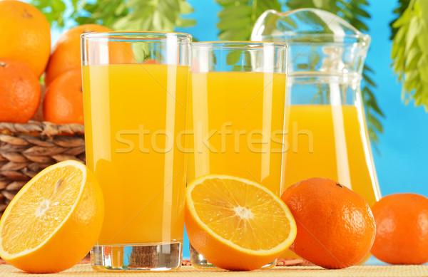Iki gözlük portakal suyu meyve ağaç çift Stok fotoğraf © monticelllo