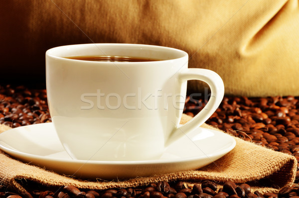 Composition with white cup and coffee beans Stock photo © monticelllo