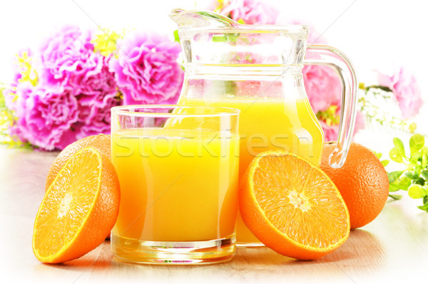 Composition with glass and jug of orange juice Stock photo © monticelllo