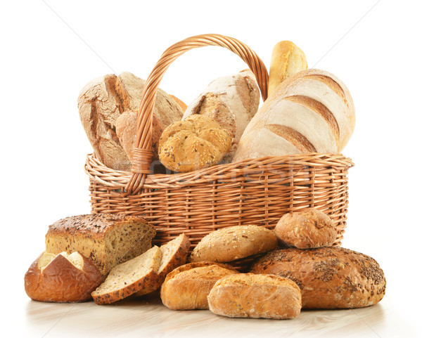 Bread and rolls in wicker basket isolated on white Stock photo © monticelllo
