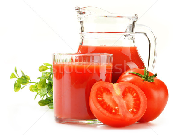 Composition with glass and jug of tomato juice isolated on white Stock photo © monticelllo