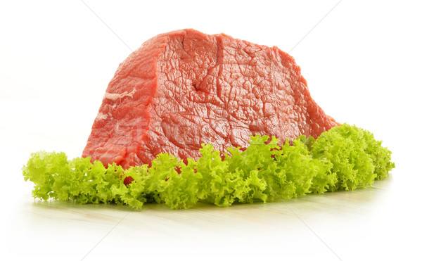 Composition with piece of beef meat and lettuce Stock photo © monticelllo