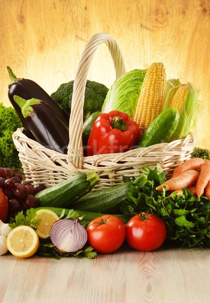 Fruits and vegetables in wicker basket Stock photo © monticelllo