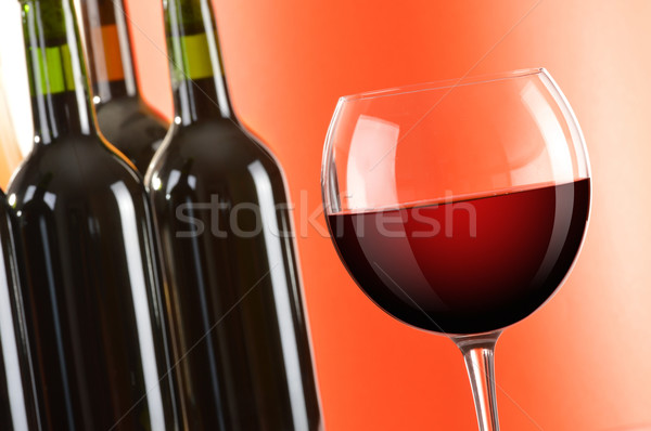 Composition with wineglass and bottles of red wine Stock photo © monticelllo