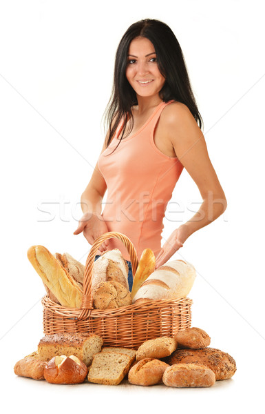 Young woman with variety of baking products isolated on white Stock photo © monticelllo