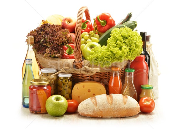 Composition with grocery products in shopping basket Stock photo © monticelllo
