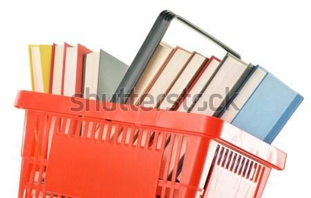 Műanyag bevásárlókosár könyvek izolált fehér Stock fotó © monticelllo