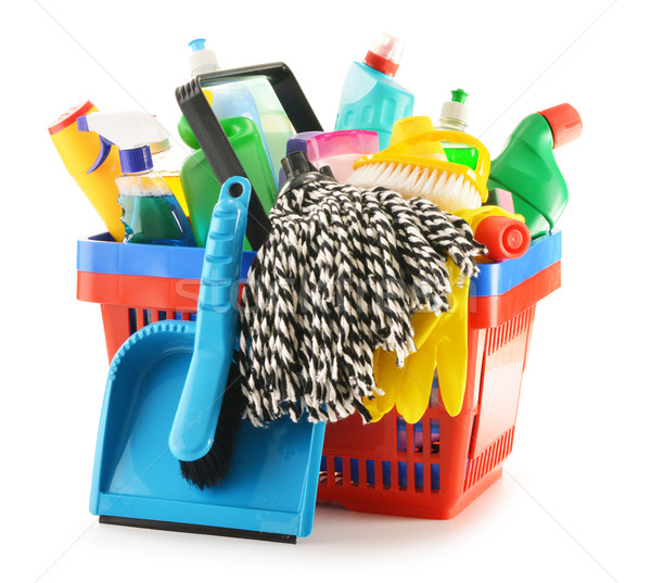Stock photo: Shopping basket with detergent bottles isolated on white