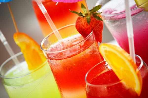 Cinco óculos bebidas água fruto laranja Foto stock © monticelllo