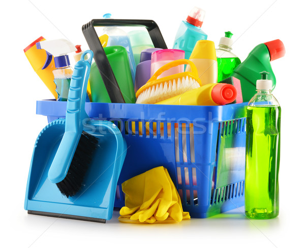 Shopping basket with detergent bottles isolated on white Stock photo © monticelllo