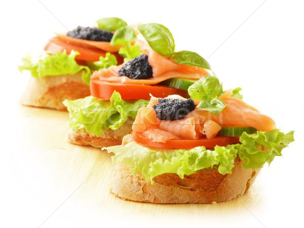 üç sandviçler somon havyar balık Stok fotoğraf © monticelllo