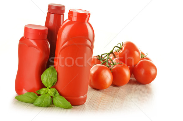 Composition with ketchup and fresh tomatoes isolated on white Stock photo © monticelllo