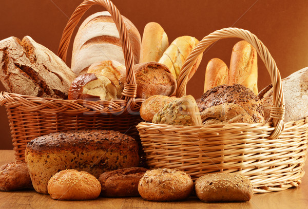 Composition with bread and rolls in wicker basket Stock photo © monticelllo