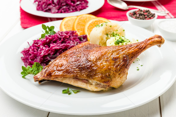 Stock photo: Duck with dumplings and red cabbage