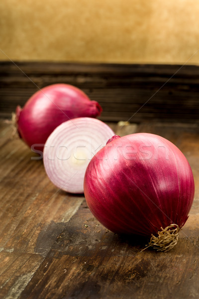Red onions on wood Stock photo © Moradoheath