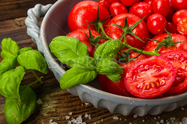 Fresh tomatoes in a bowl Stock photo © Moradoheath