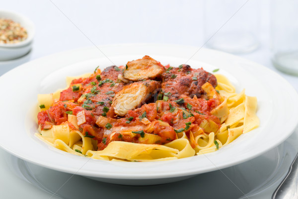 Ribbon pasta with chicken and tomato leek sauce Stock photo © Moradoheath