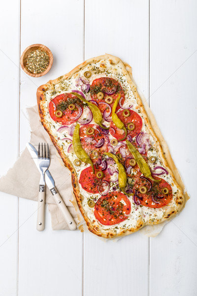 Spicy tarte flambee with pepperoni and olives Stock photo © Moradoheath