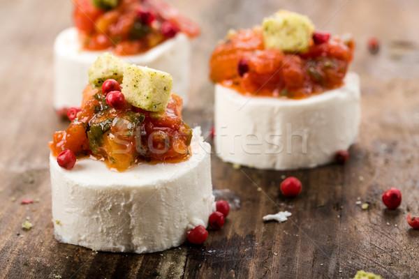 Сыр из козьего молока свежие розовый перец томатный продовольствие Сток-фото © Moradoheath