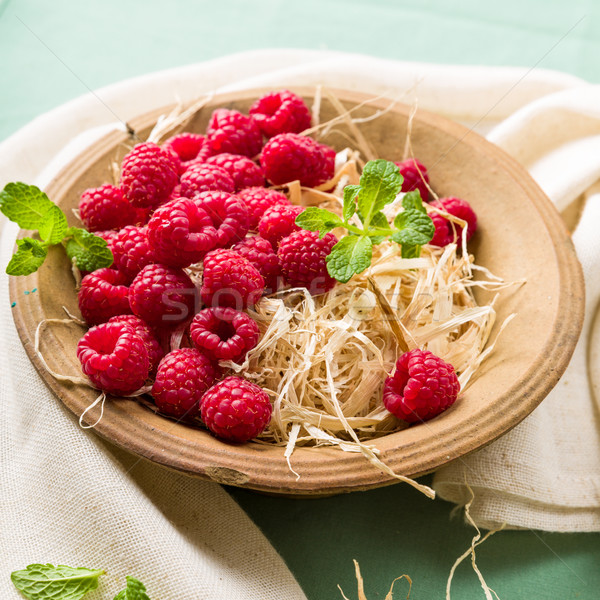 Raspberries in a bowl Stock photo © Moradoheath