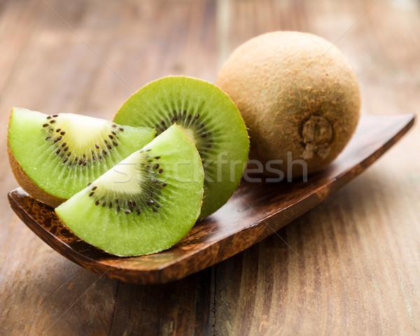 Kiwi ensemble coupé bois bol Photo stock © Moradoheath