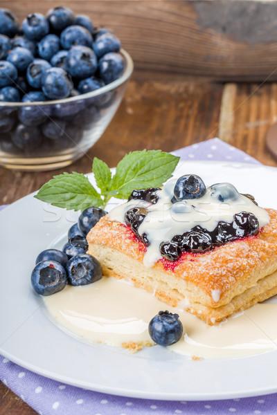 Puff pastry with blueberries vanilla sauce Stock photo © Moradoheath