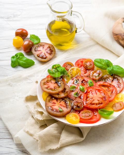 Coloré tomate salade basilic vert jaune Photo stock © Moradoheath