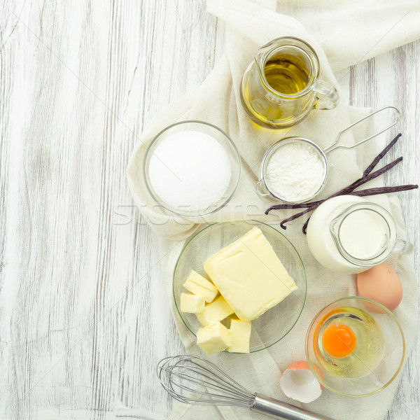 baking ingredients eggs, flour, sugar, butter, vanilla, cream Stock photo © Moradoheath