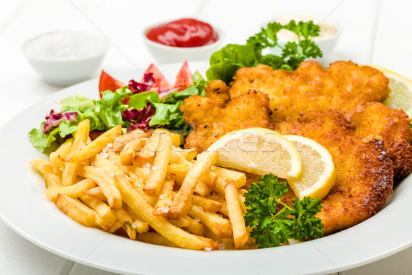 Chicken cutlets with fries and salad Stock photo © Moradoheath