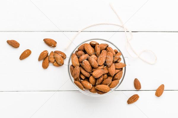Almonds on a white background Stock photo © Moradoheath